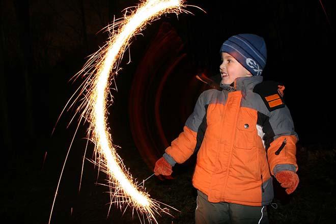 Child enjoying a sparkler on bonfire night