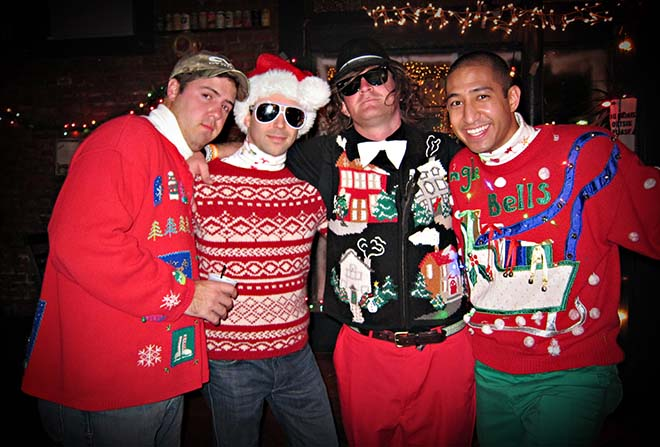 Four guys in ugly christmas Jumpers